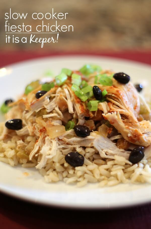 Easy crock pot recipes are an essential tool in any busy mom's toolbox. This recipe for Slow Cooker Mexican Fiesta Chicken is one of those easy recipes and healthy meals that comes together in a snap and is easy on the waistline! This is one of the best crock pot chicken recipes.