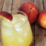 This refreshing Summer Peach Spritzer is an easy cocktail recipe - It is a Keeper