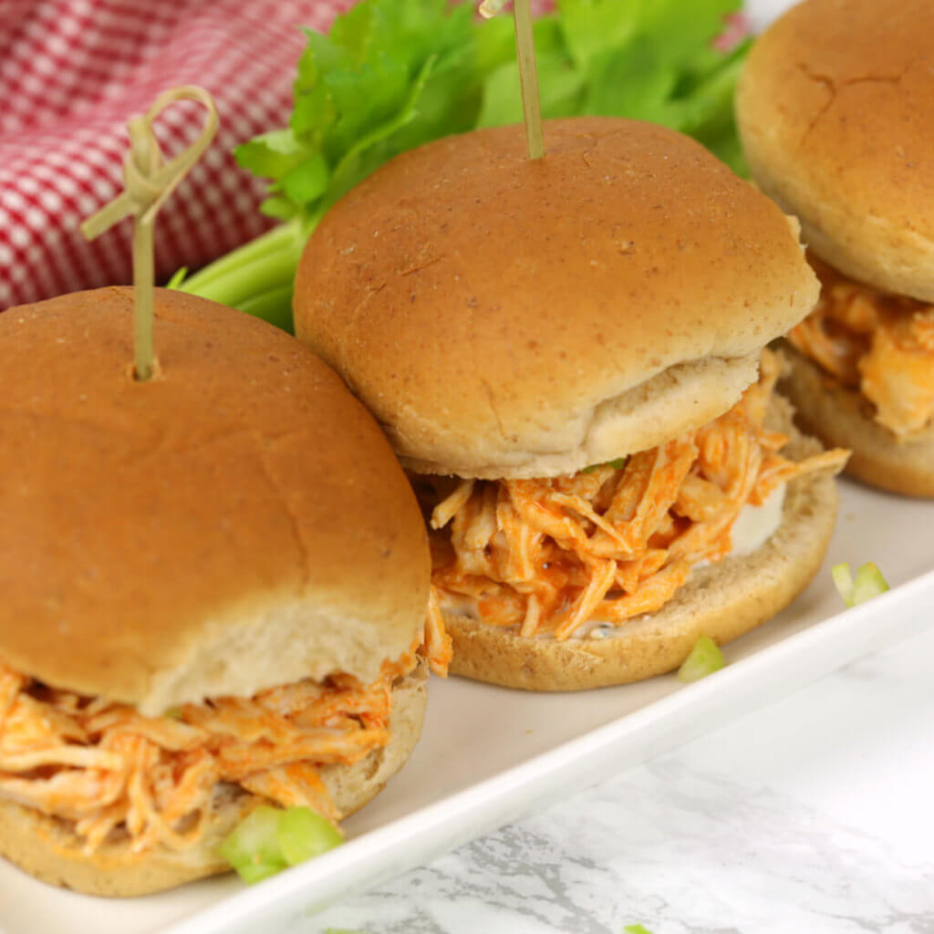 Slow Cooker Buffalo Chicken Sliders - these sandwiches are one of my favorite easy crock pot recipes for chicken