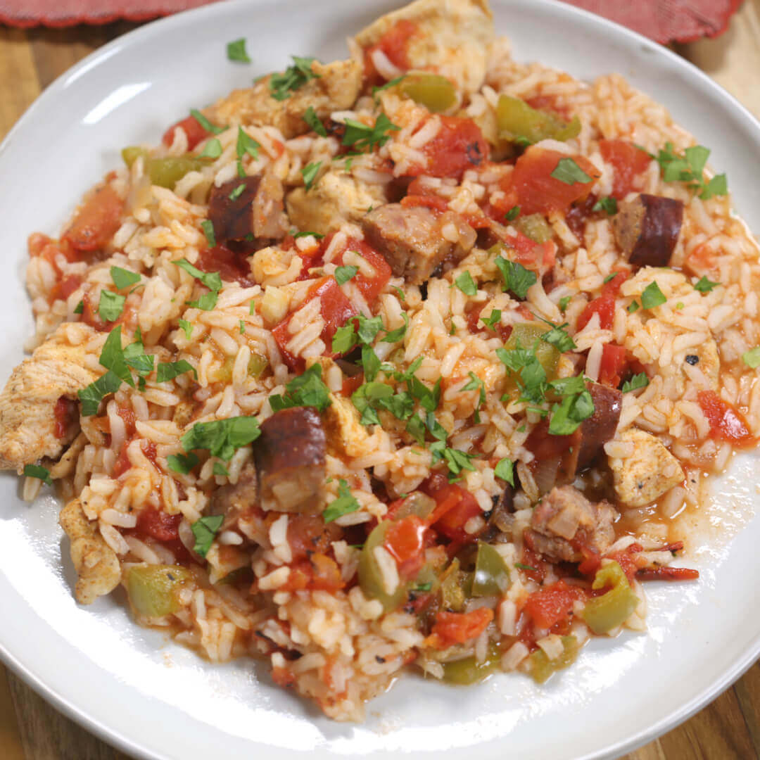 This easy Louisiana Jambalaya Recipe is perfect for busy nights. With very little hands-on time it's easy to make and packed with flavor.