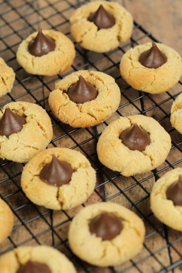 Peanut Butter Kiss Cookies on a wire baking rack