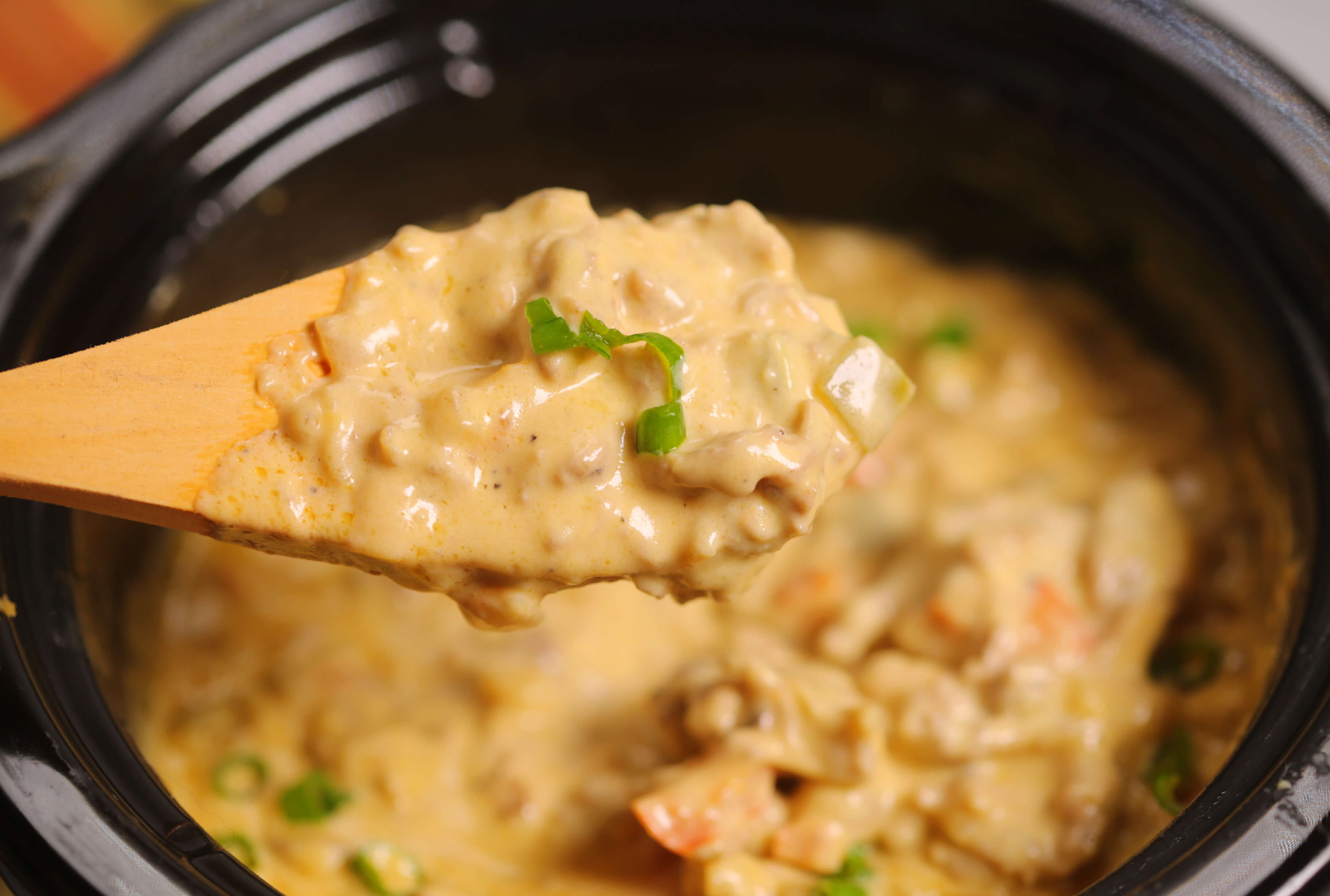 Philly Cheesesteak Dip on a wooden spoon