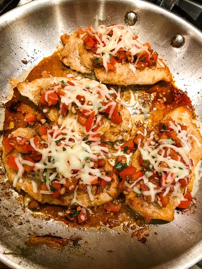Bruschetta chicken in a frying pan