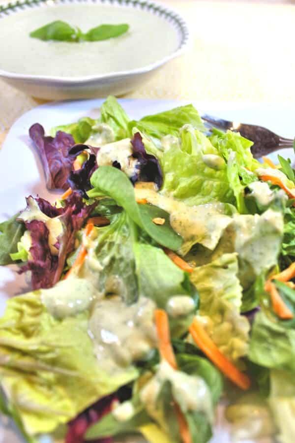 green goddess salad dressing on top of a salad