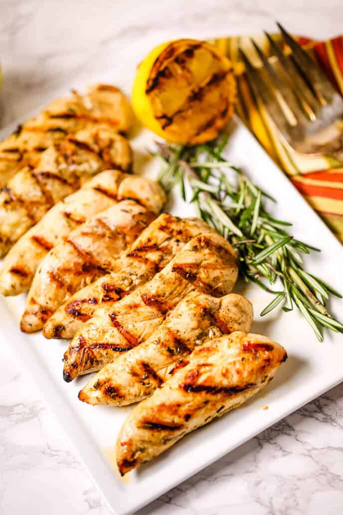 Chicken with a side of grilled lemon and rosemary