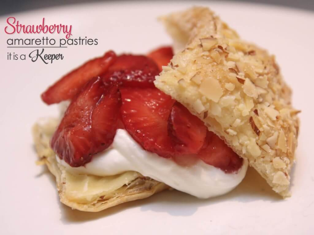 Strawberry Amaretto Pastries on a white table.