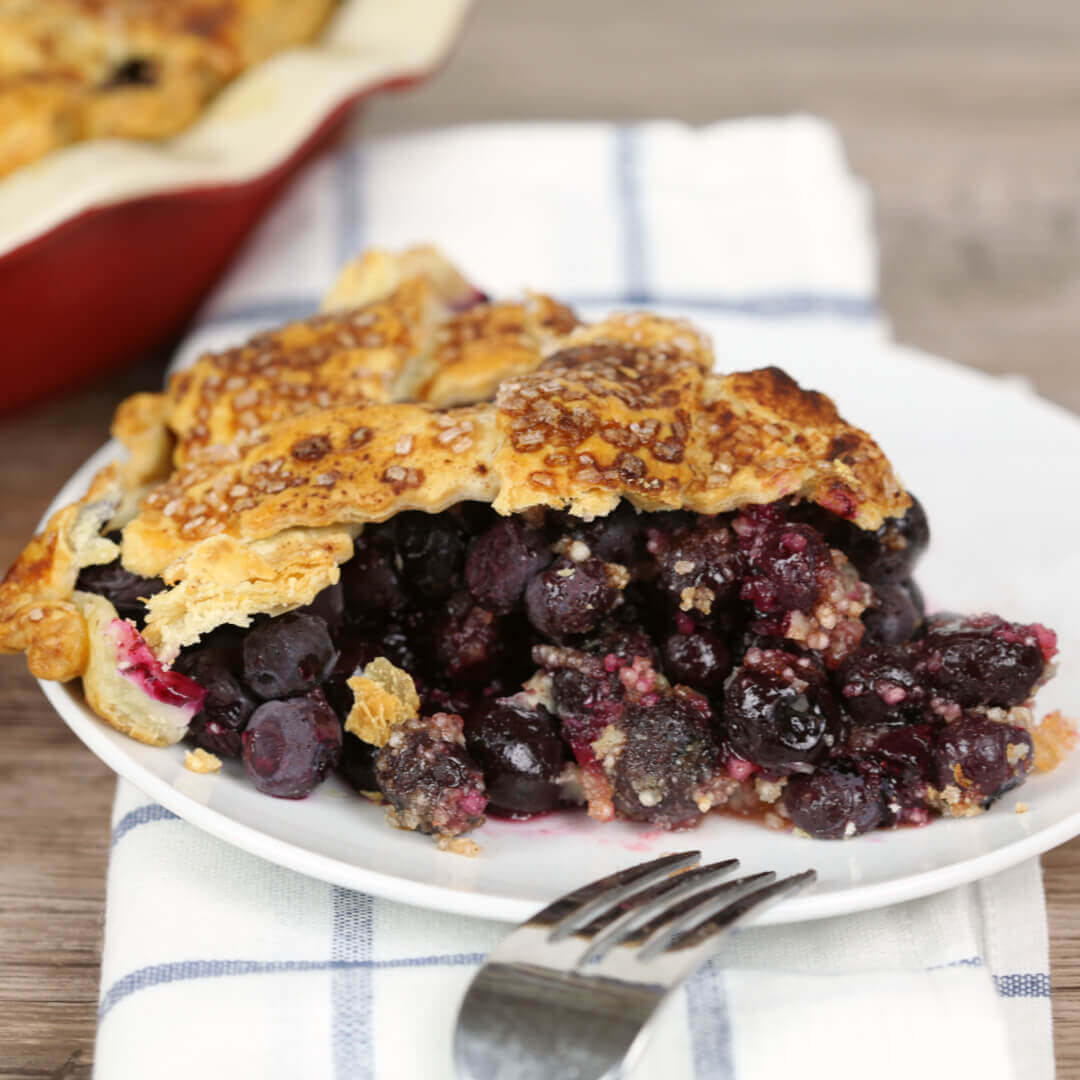 Perfect Blueberry Pie piece on a white plate
