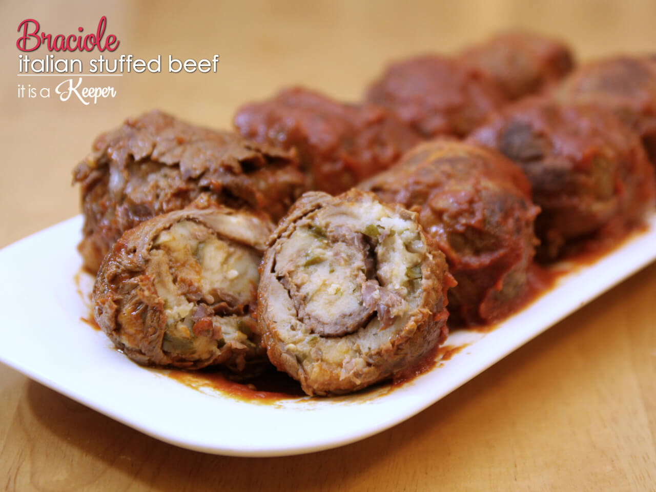 Braciole - this recipe is a traditional Italian recipe of beef that is stuffed and braised in tomato sauce
