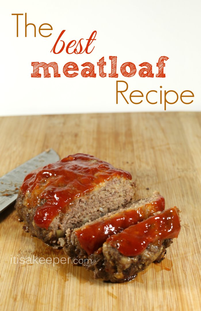 meatloaf w/ a layer of ketchup on top, cut up and laid out on a wooden cutting board