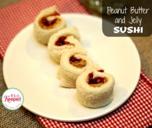 Peanut Butter and Jelly Sushi on a white plate with a red checkered napkin.