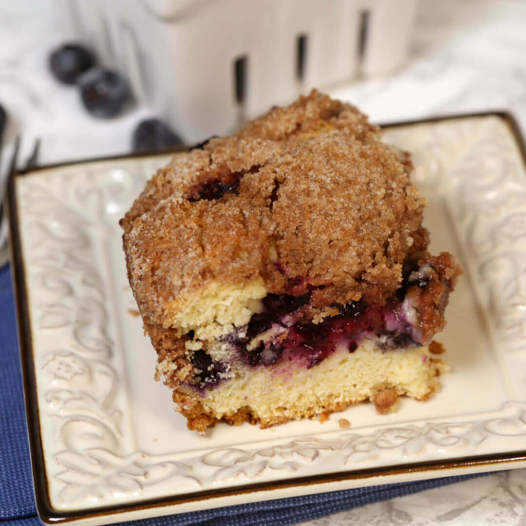 Blueberry Coffee Cake on a white plate.