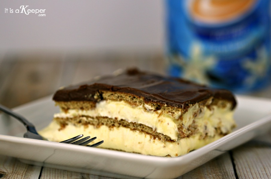 No Bake Desserts Chocolate Eclair Cake on white plate with metal fork.