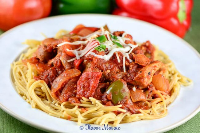 This Slow Cooker Chicken Cacciatore is a hearty, slow cooked Italian chicken main dish with tomatoes, onions, garlic, and red and green bell peppers, served over pasta. This is one of the best slow cooker chicken recipes.