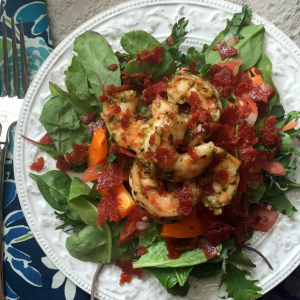 pesto shrimp and pepperoni salad with lemon garlic vinaigrette