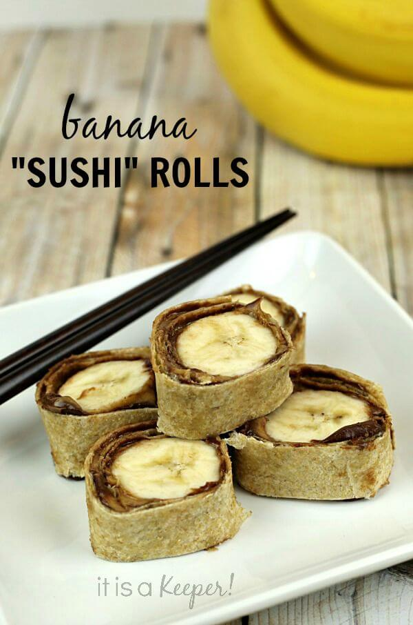 Banana Sushi Rolls on a white plate accompanied by black chop sticks for eating