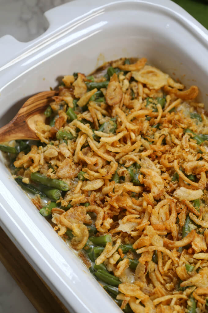 Crockpot Green Bean Casserole is a time saving twist on a classic Thanksgiving recipe. It's easy to put together and doesn't take up precious oven space on the big day.  It's definitely one of the best slow cooker recipes of all time.