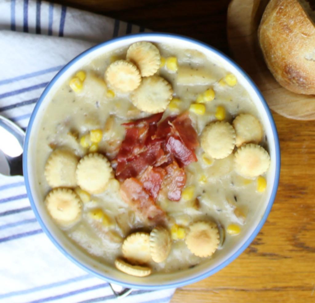 Potato Corn Chowder in a blue and white bowl and napkin.