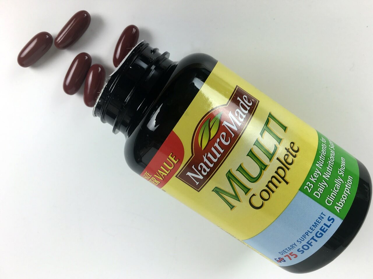 bottle of nature made multi complete supplement spilling onto counter