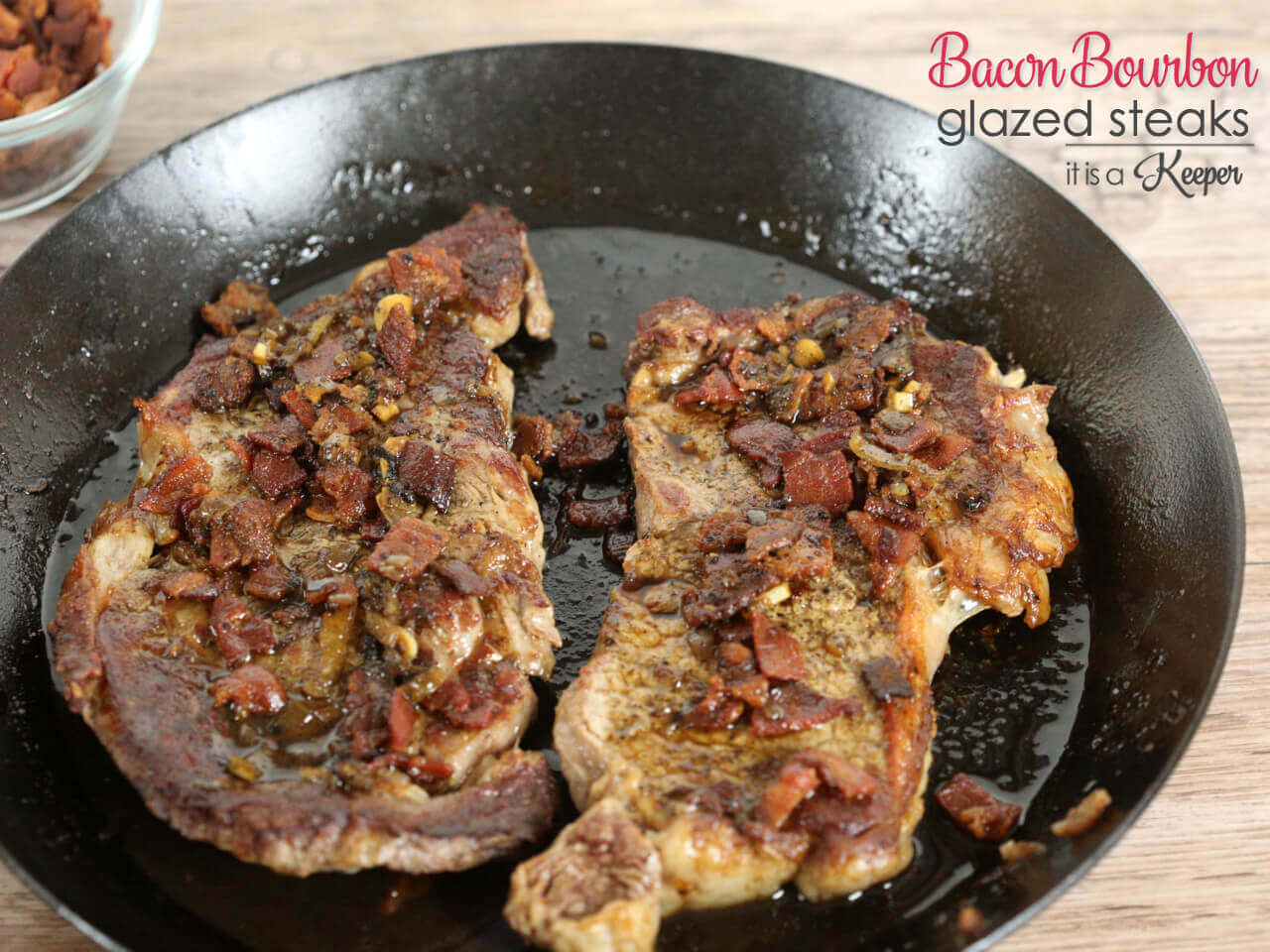 Bacon Bourbon Glazed Steaks in cast iron skillet
