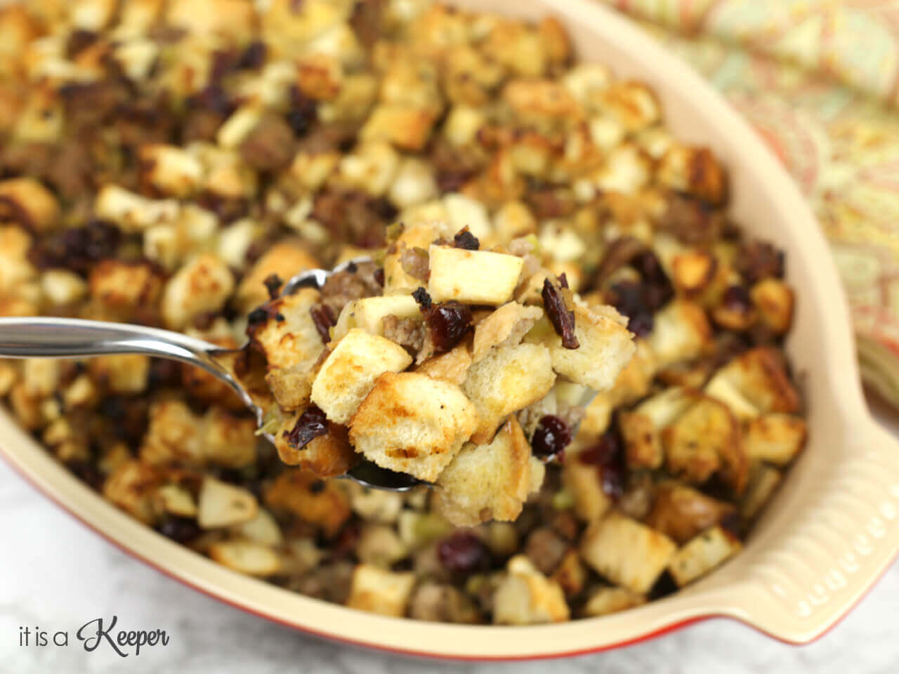 Sausage and Apple Stuffing - this easy dressing recipe is loaded with apples, sausage, cranberries and pecans