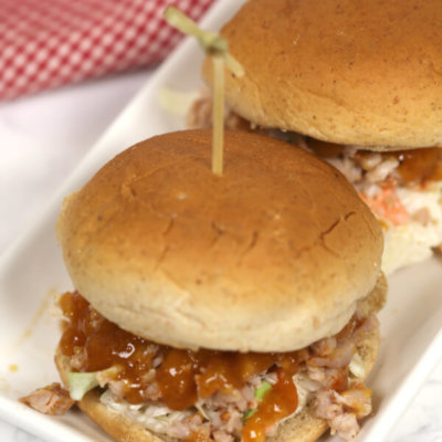 Chipotle Pork Tenderloin Sliders - this easy sandwich recipe is topped with chipotle slaw and a luscious peach bbq sauce