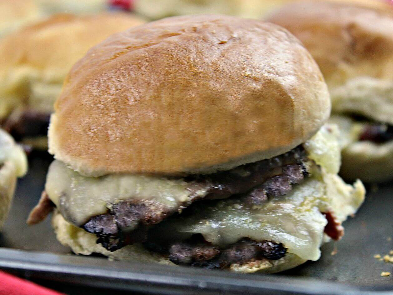 Roast Beef Sliders with Dijon Sauce - these easy roast beef cheese sliders are oozing with flavor