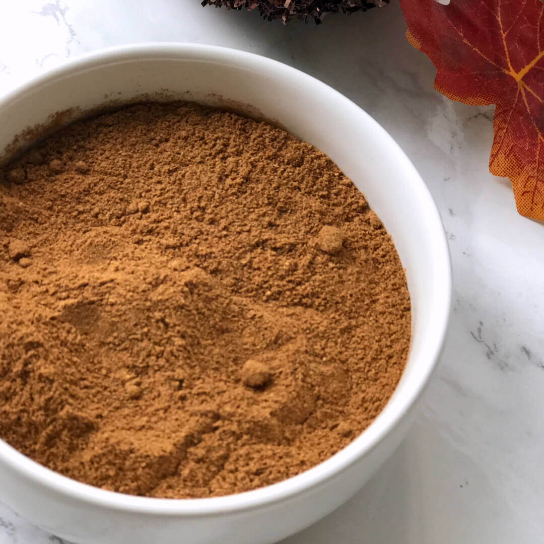 pumpkin pie spice mix in a white bowl.