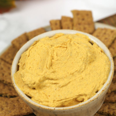 Close up of Pumpkin Dip with a circle of crackers around it