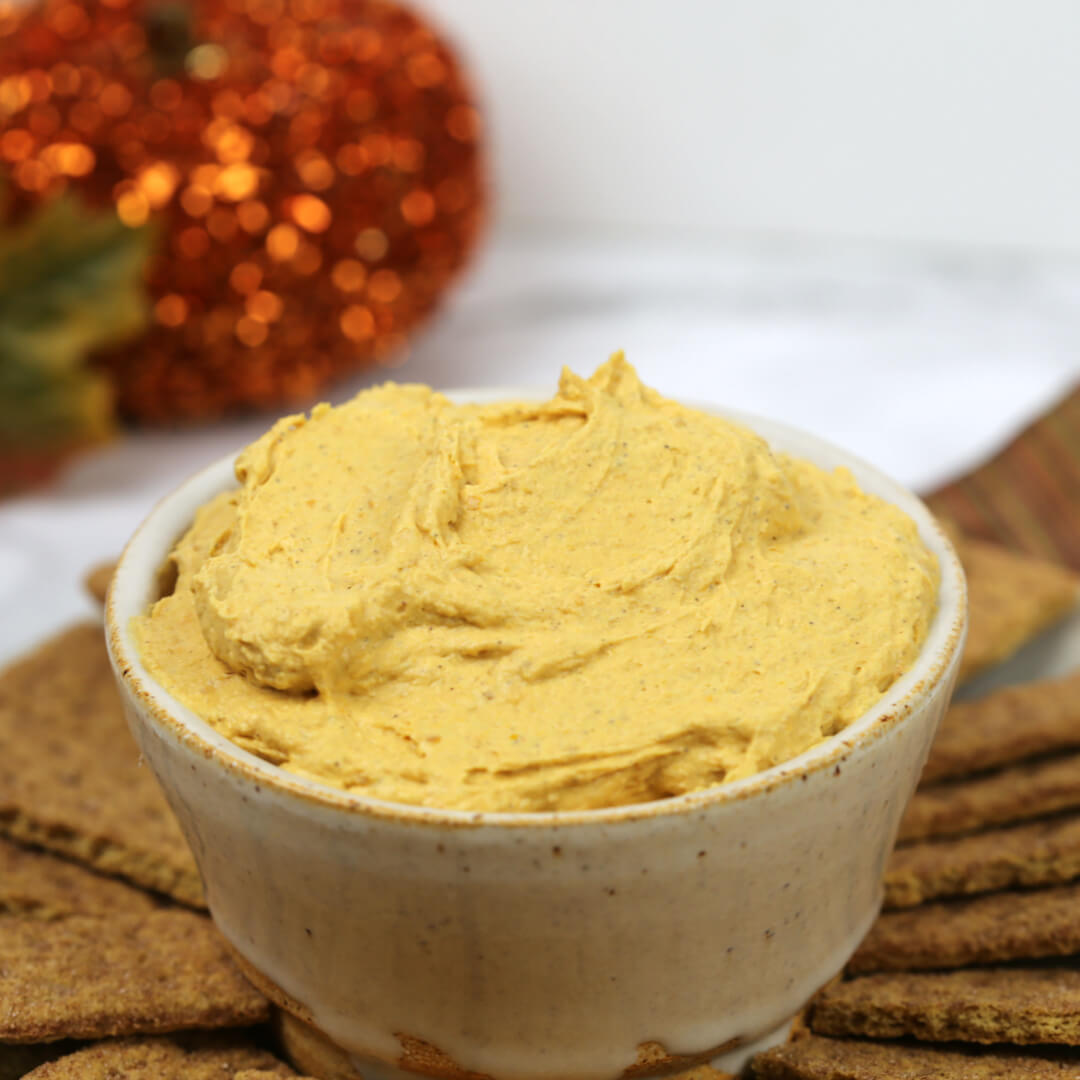 Easy Pumpkin Pie Dip in white bowl with graham crackers.