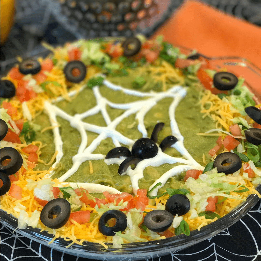 Halloween Taco Dip in black spider bowl.