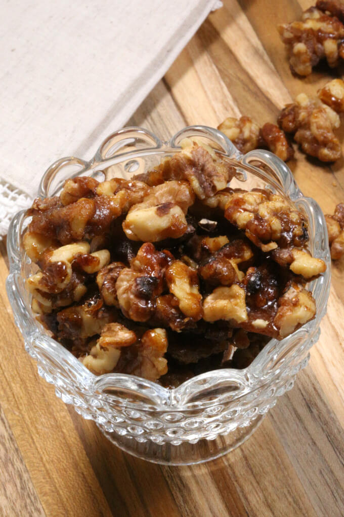 Made with walnuts, sugar, butter & cinnamon, these easy Candied Walnuts take a few minutes to make.  They're so good, you'll want want to make a few batches.