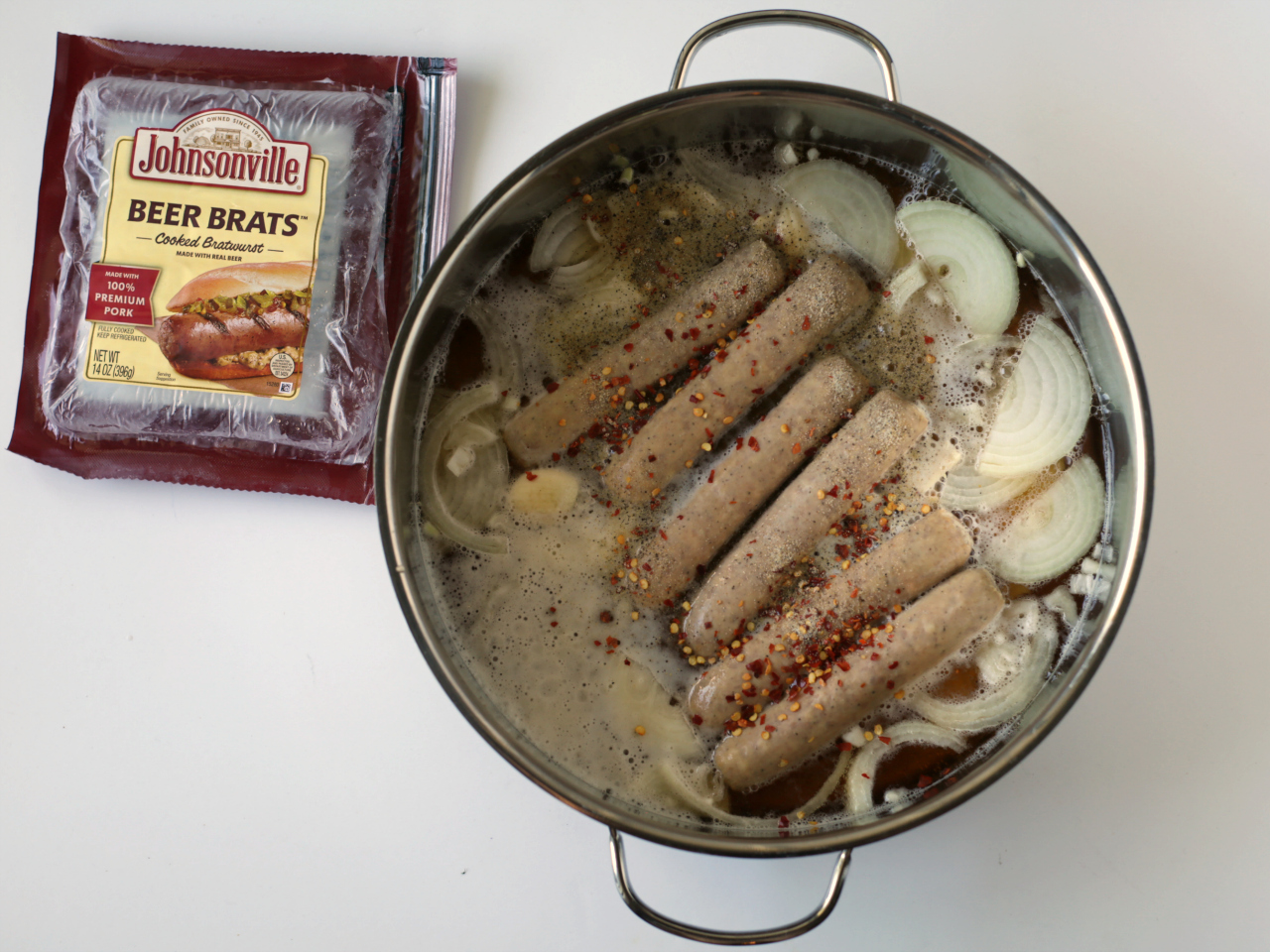 Grilled Beer Brats package, empty. Brats, onions, garlic and seasoning in pot.