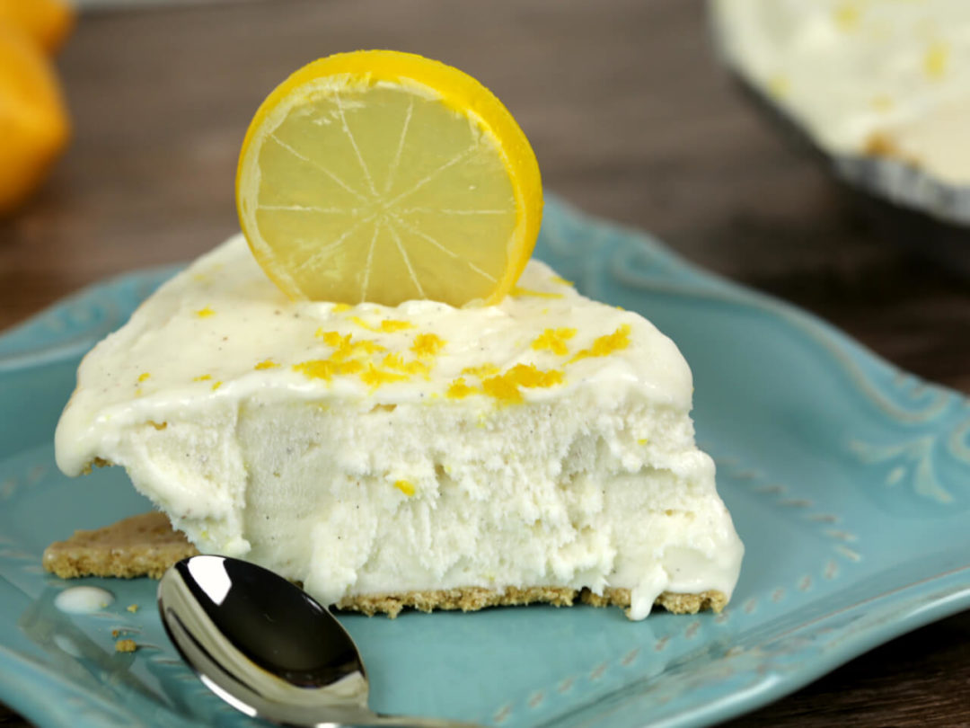 easy no bake lemon pie on a blue plate with a spoon.