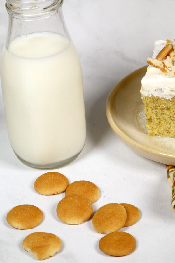 banana cake recipe with a side glass of milk.