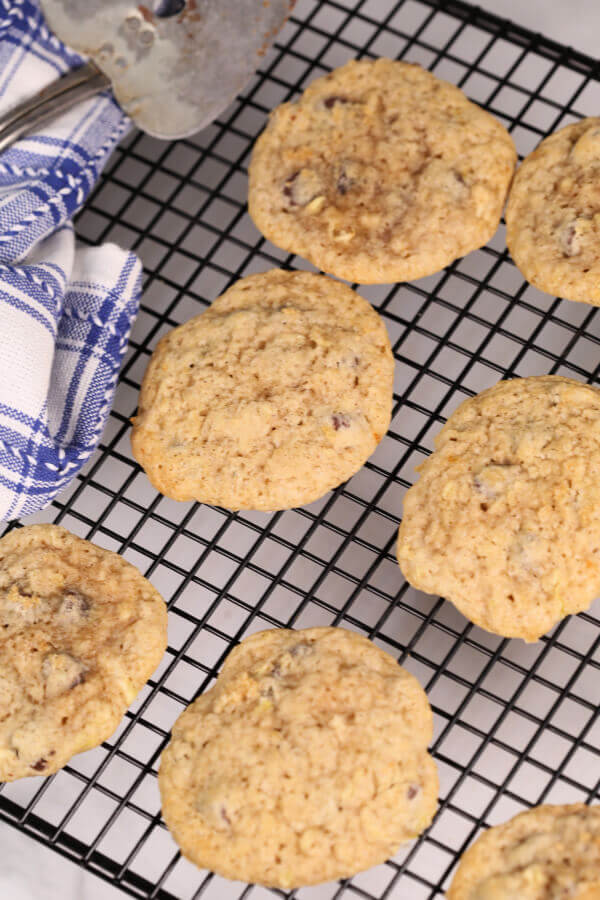 Easy Zucchini Cookies on dish with blue and white plaid napkin.