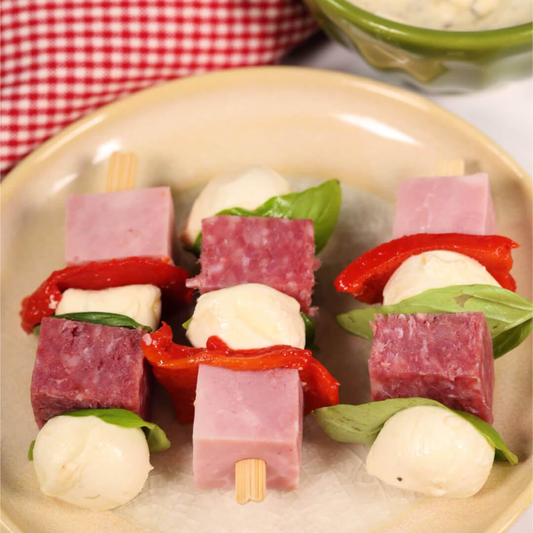 Italian lunchbox Kabob on a beige plate.