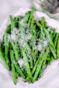 parmesan green beans on a white plate
