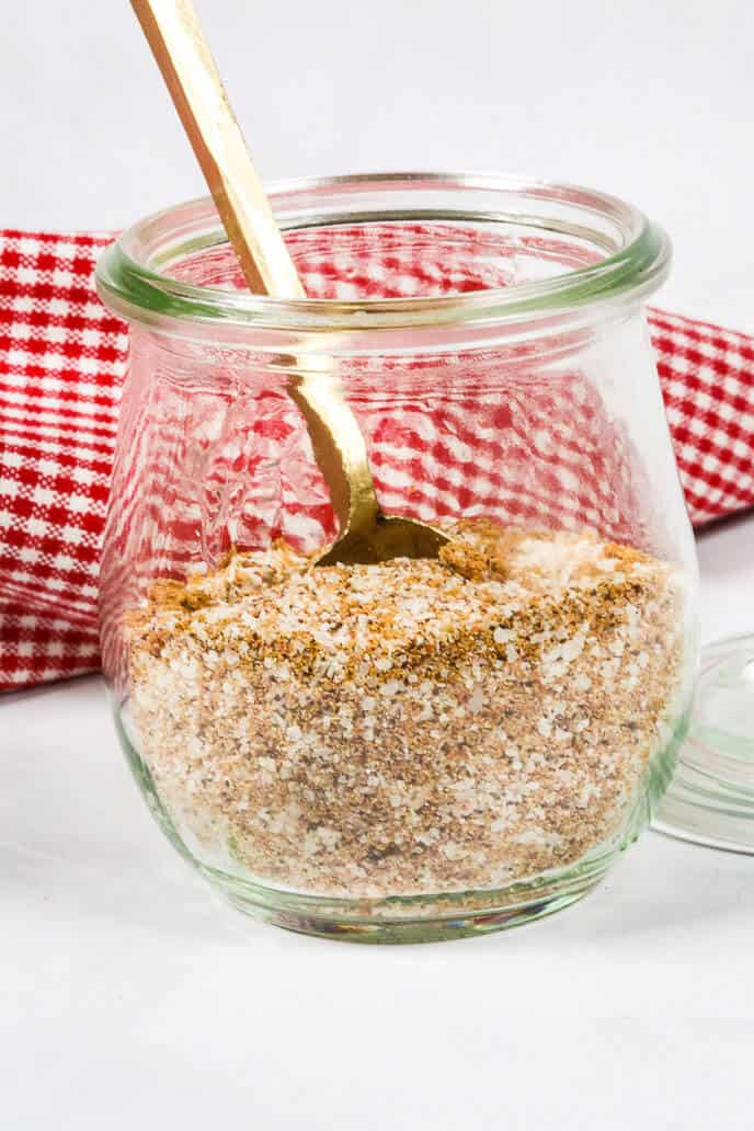 Steak rub in a jar with a gold spoon for making the best steak recipe