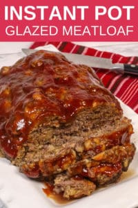 Instant Pot Meatloaf on a white platter with a red striped napkin