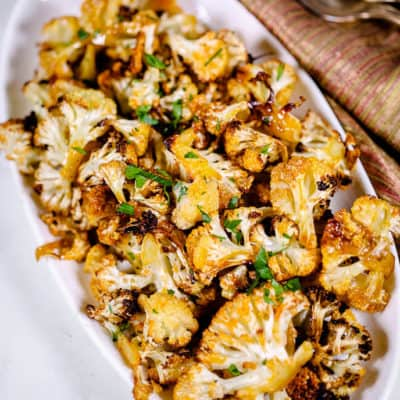 Spicy cauliflower on a white plate with red napkin