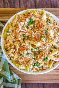 Garlic Parmesan Chicken Pasta in white dish with green check napkin