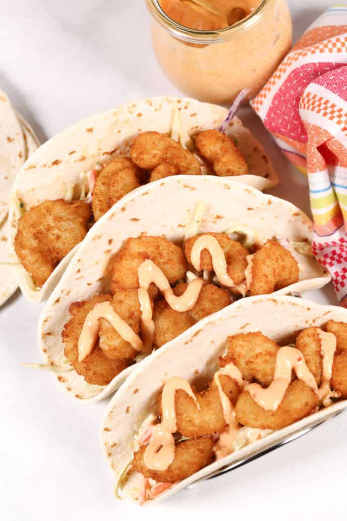 Shrimp Tacos with Boom Boom Sauce with Jar or sauce and Napkin