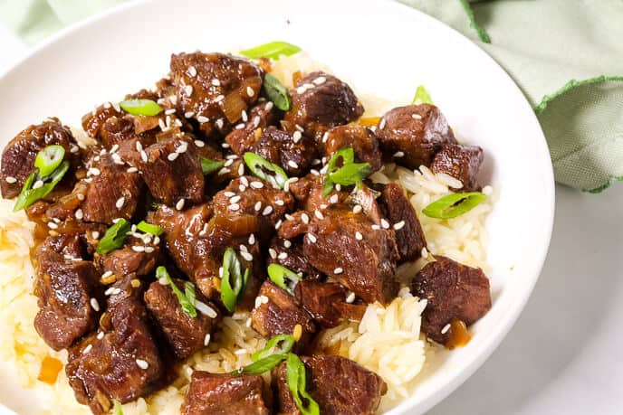 Tender Korean Beef with Sesame seeds and scallions on a bed of rice