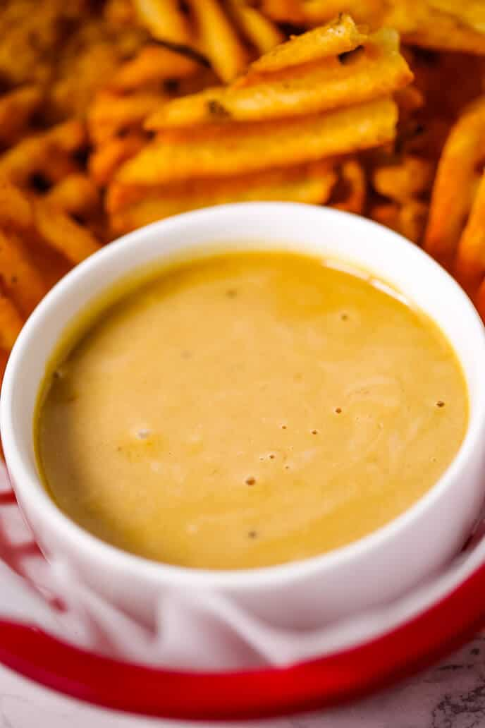 Copycat Chick Fil A Sauce Recipe in a white bowl with waffel fries.