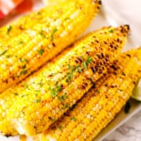 Corn on the cob with a red and white check napkin
