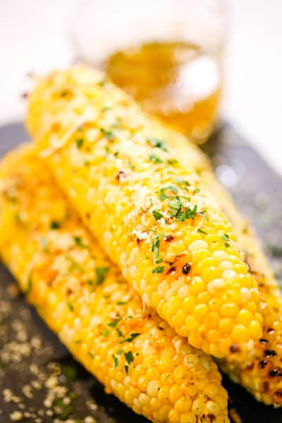 Grilled corn on black dish