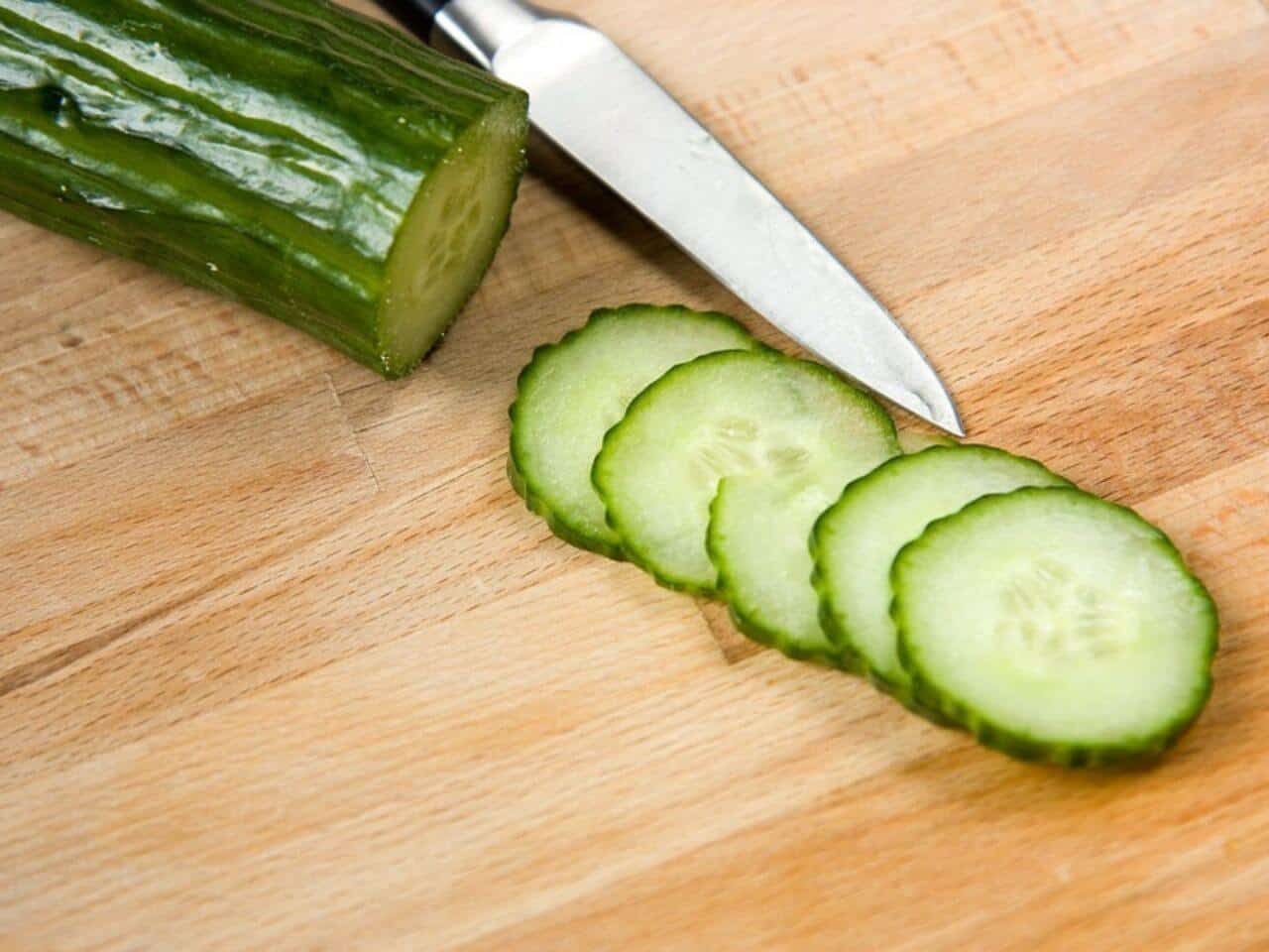 Sliced English Cucumber sliced on a wooden cutting board