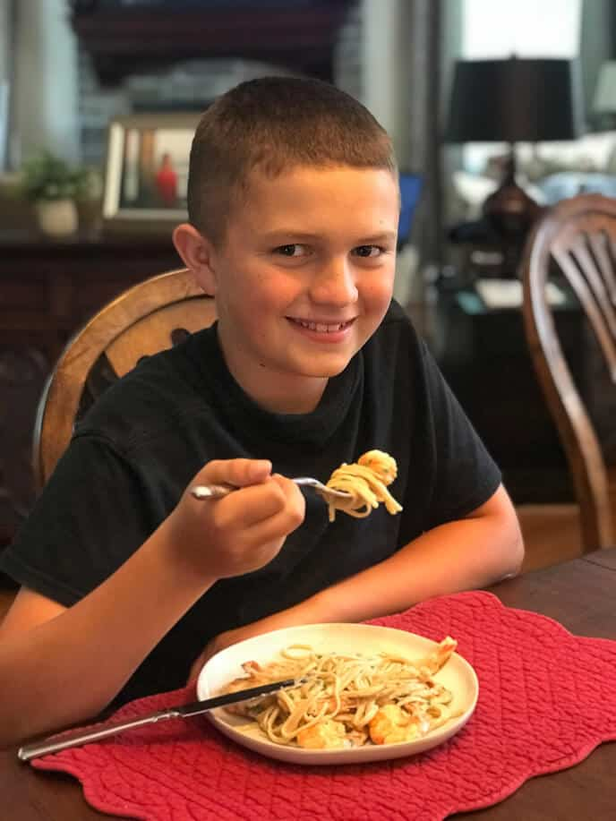 My son eating shrimp alfredo recipe