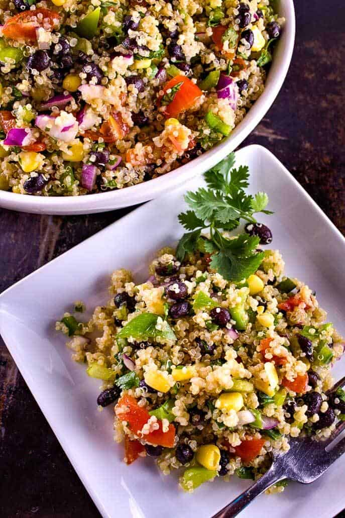 Picture of quinoa salad in a bowl and on a serving dish with fork