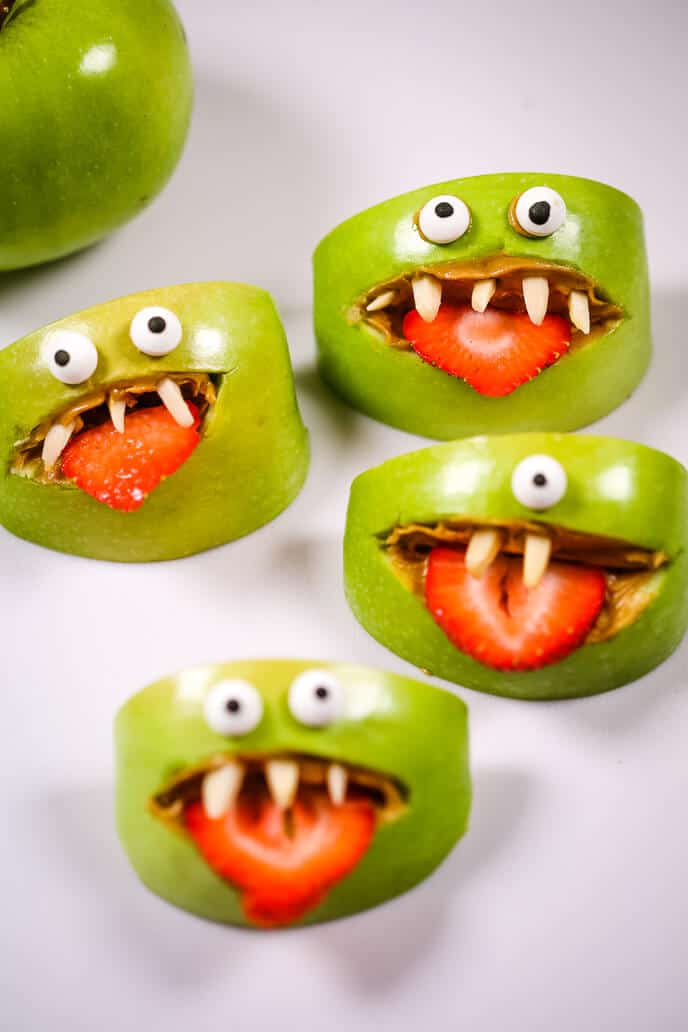 Apple monster halloween snacks on a white table